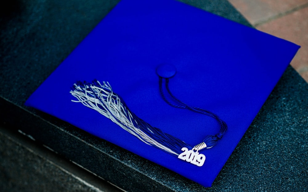 blue and white academic hat