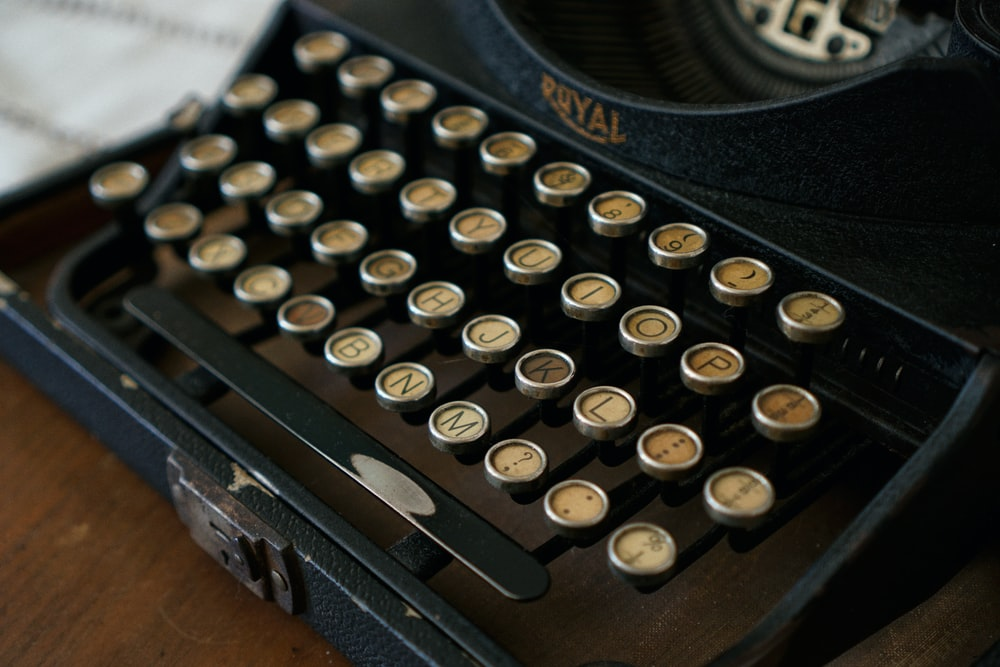 gray and brown Royal typewritter