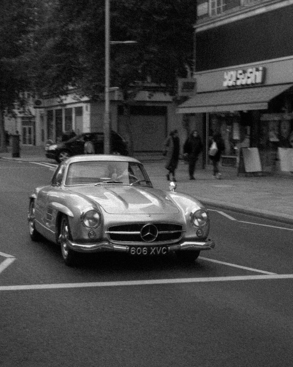 silver Mercedes-Benz car on road