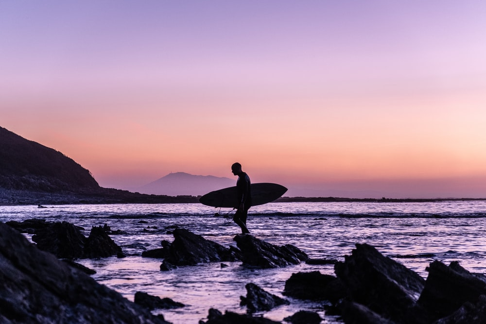 man holding surfboard