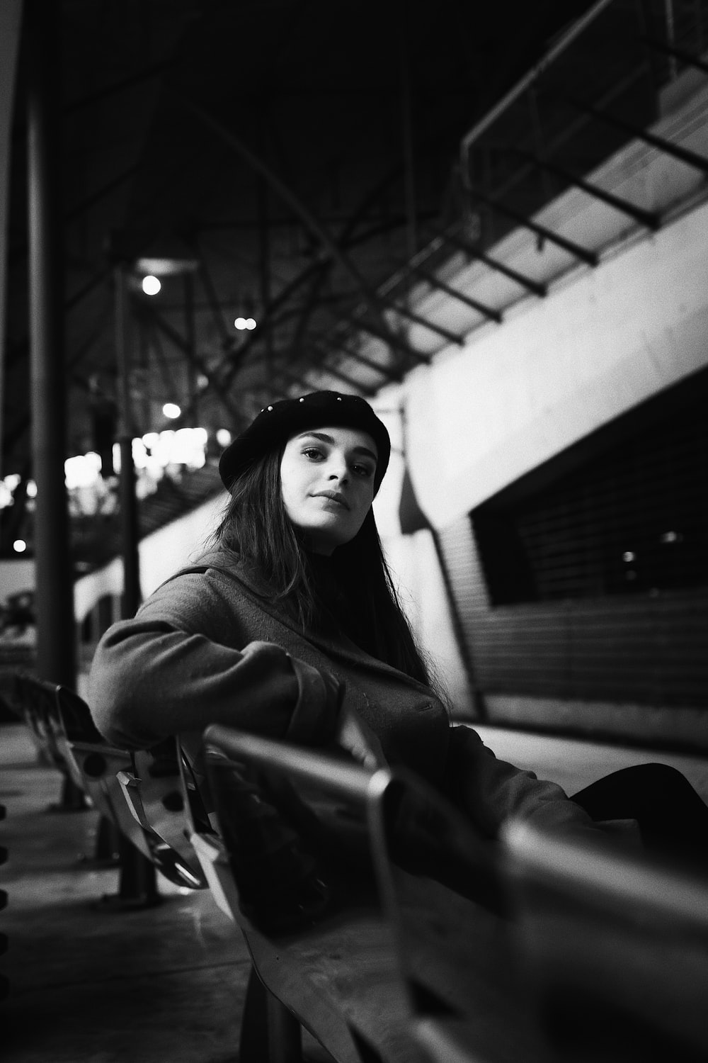 grayscale photography unknown person sitting indoors