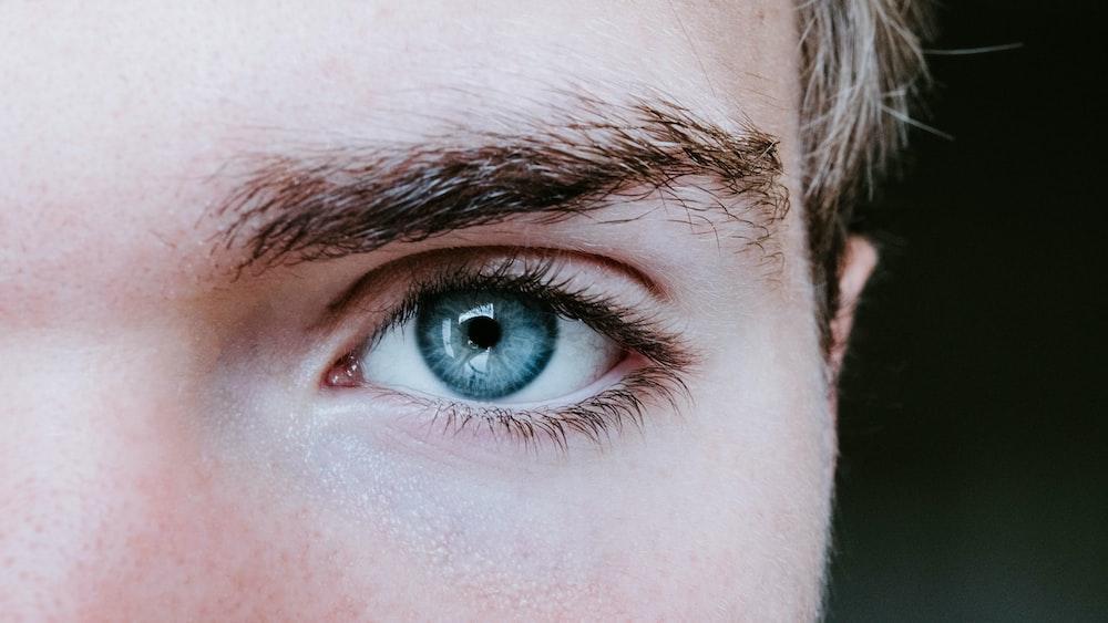 man's blue left eye