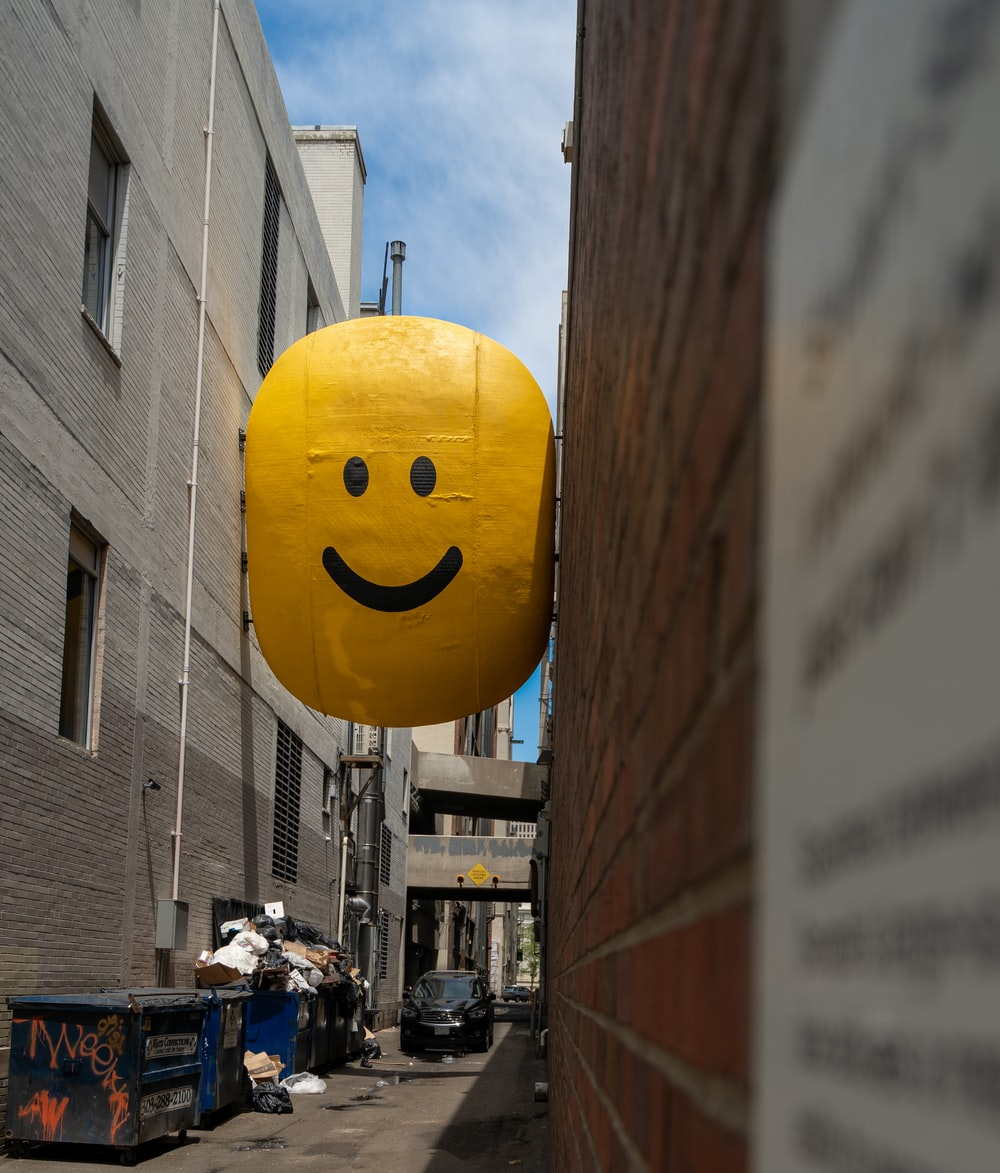 yellow emoji signage