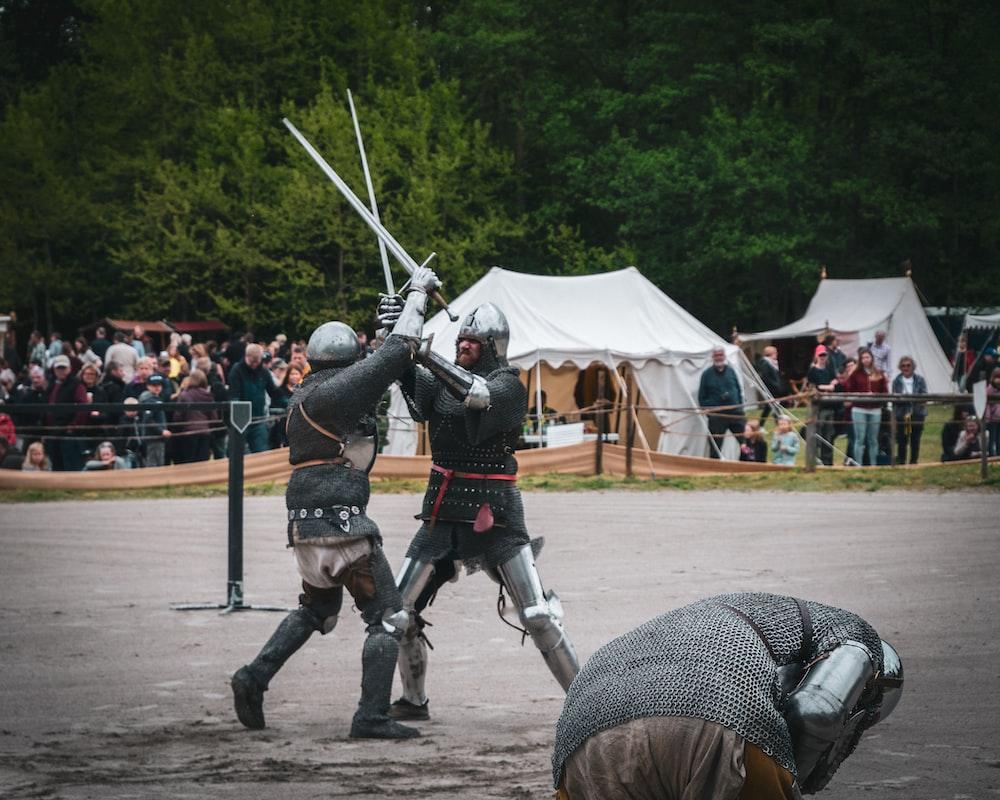 men fighting with sword