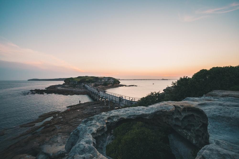 bridge on sea at golden hour