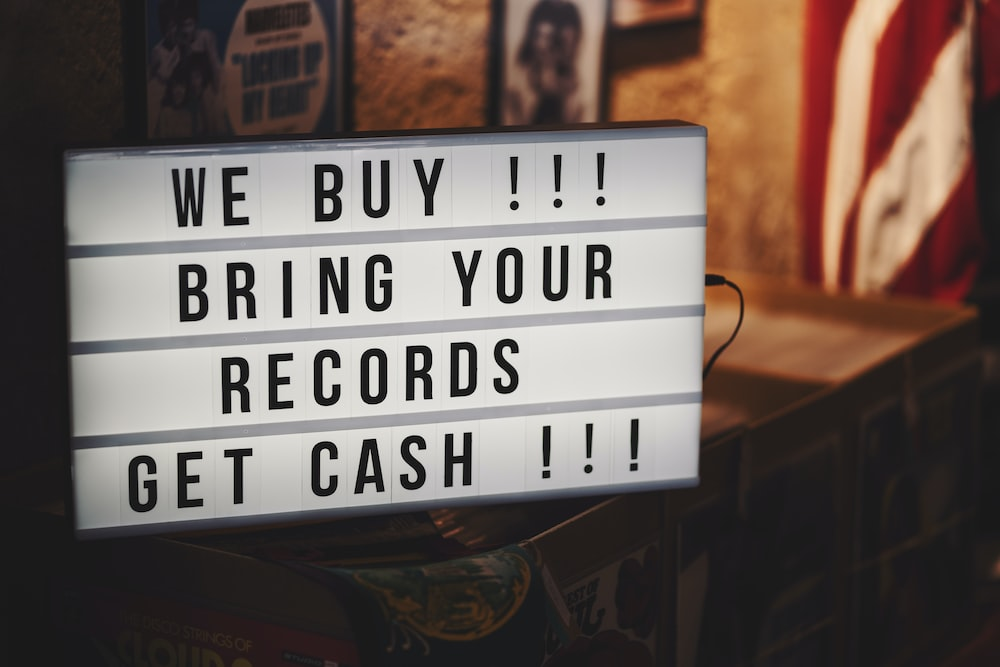 WE Buy Bring Your Records Get Cash sign