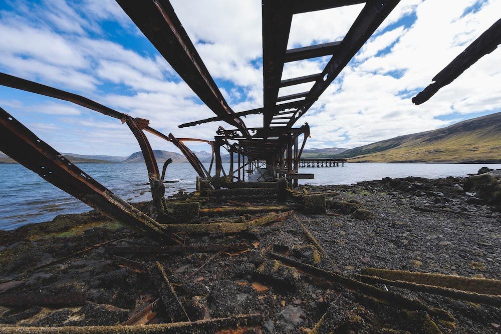 bridge ruins under cloudy sky during daytime
