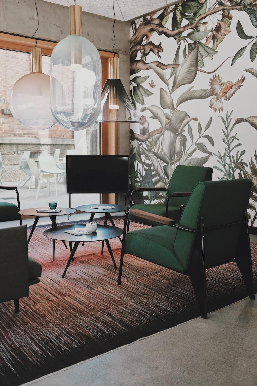 green fabric padded sofa chair