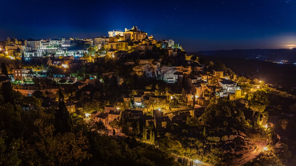 aerial view of lighted houses during night time