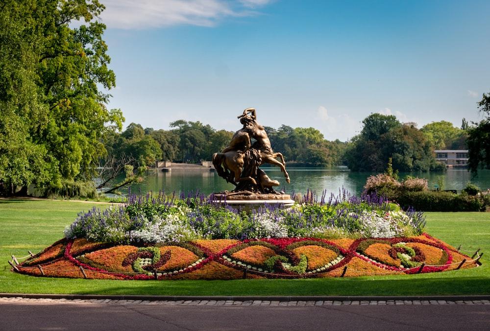 brass centaur statue with fountain