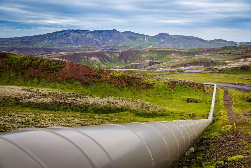 gray pipe on green grass