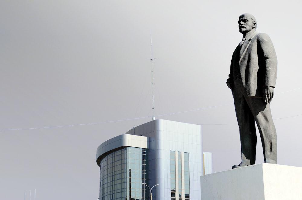 gray concrete man statue