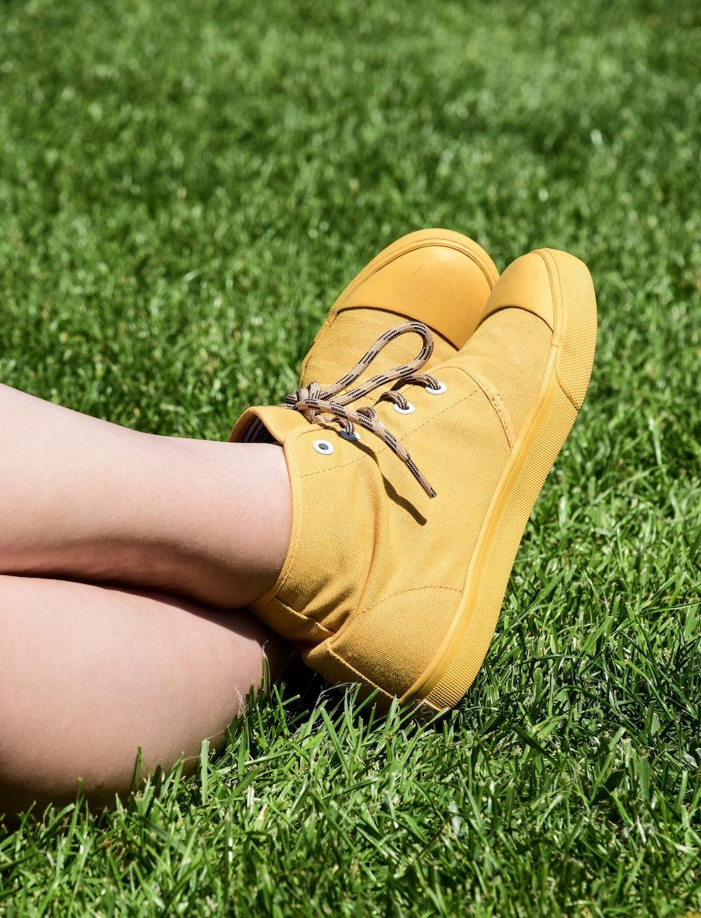 pair of brown high-top sneakers