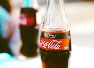 Coca-Cola soda bottle on table
