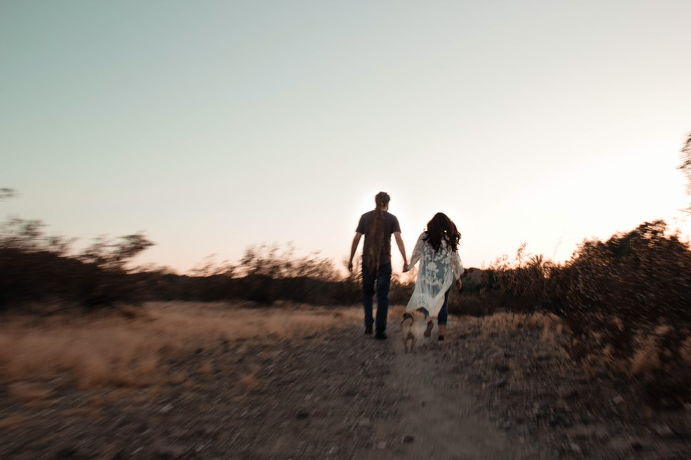 man and woman near road