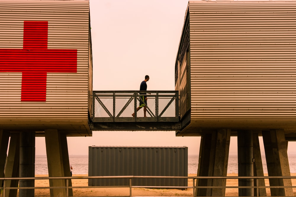 person standing on intermodal container