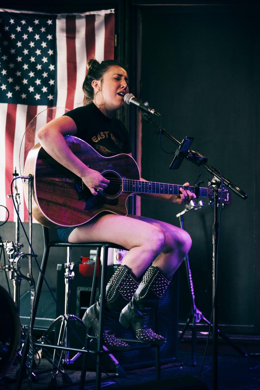 woman playing guitar\