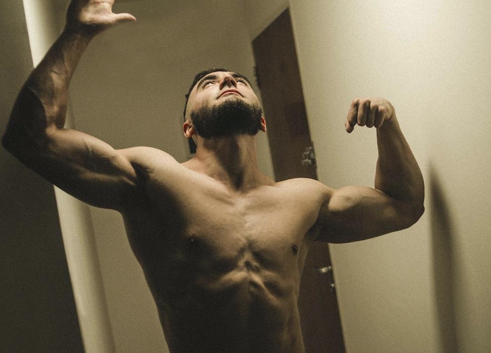 topless man on hallway