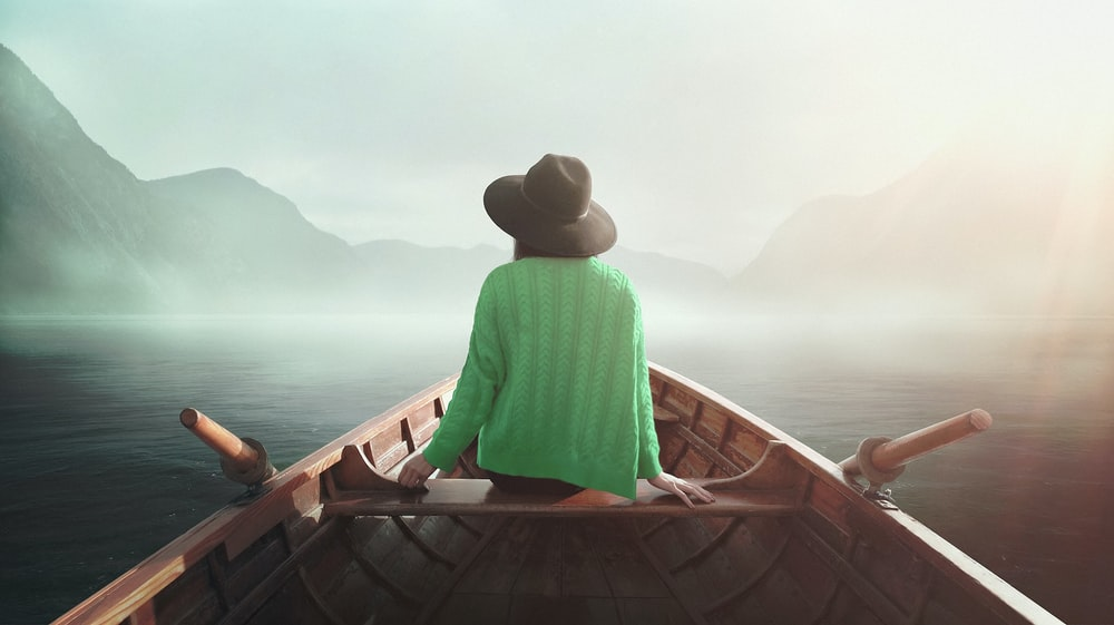 woman sitting on boat