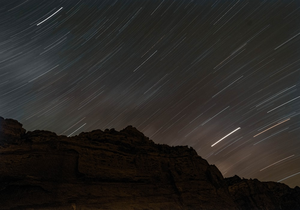 time lapse photography of mountain at night time
