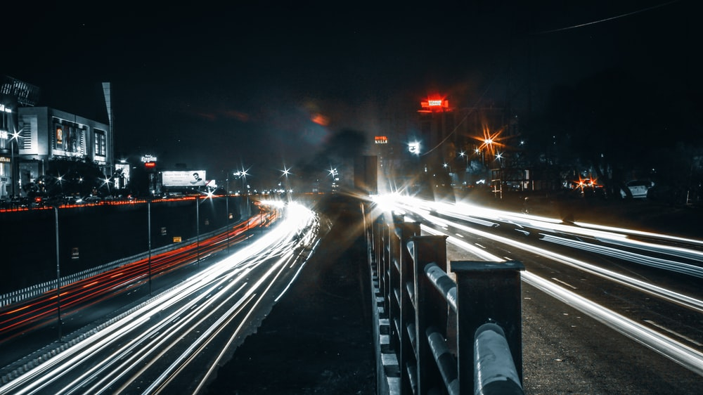cars with lights on in city highways