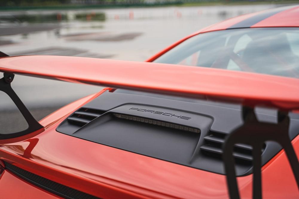 red Porsche sports bike with spoiler
