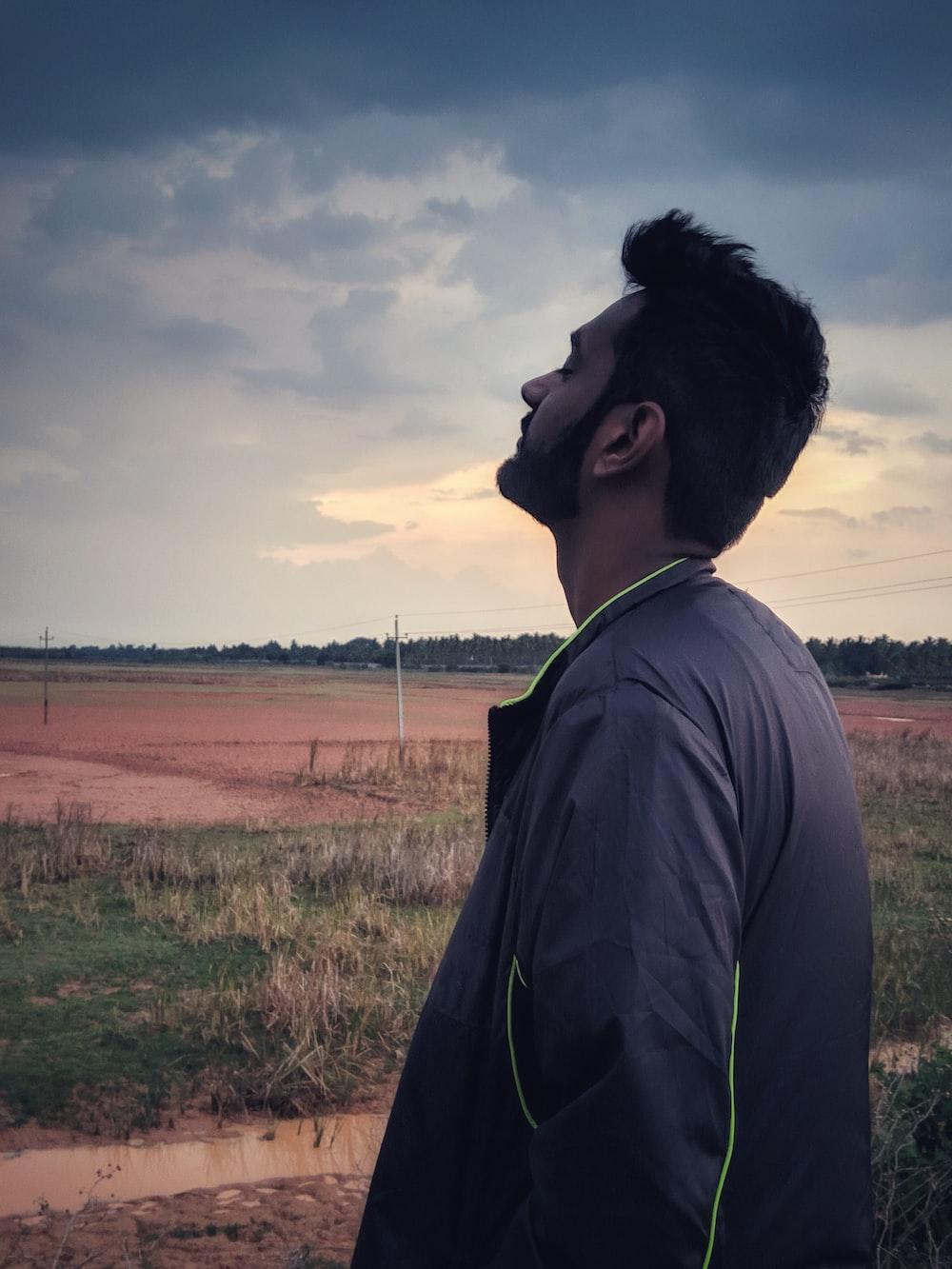 man standing on gras field