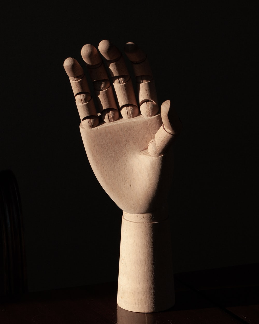 right human dummy hand on brown surface