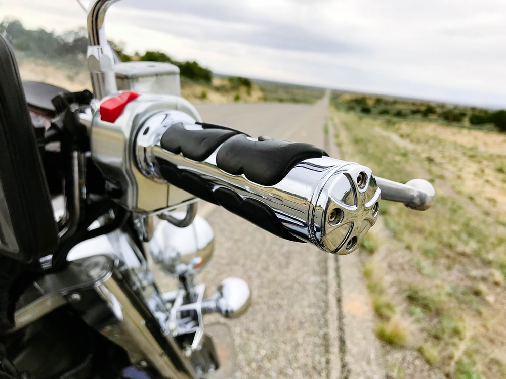motorcycle with chrome hand grip stopped at roadside