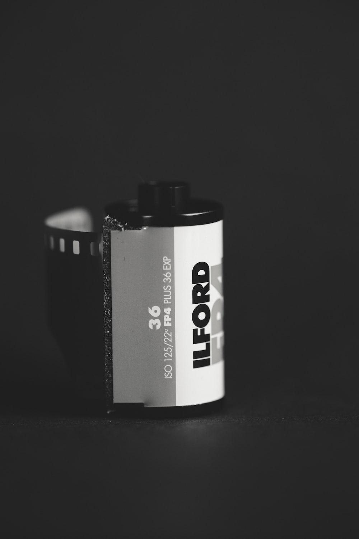 white Ilford camera film on black surface