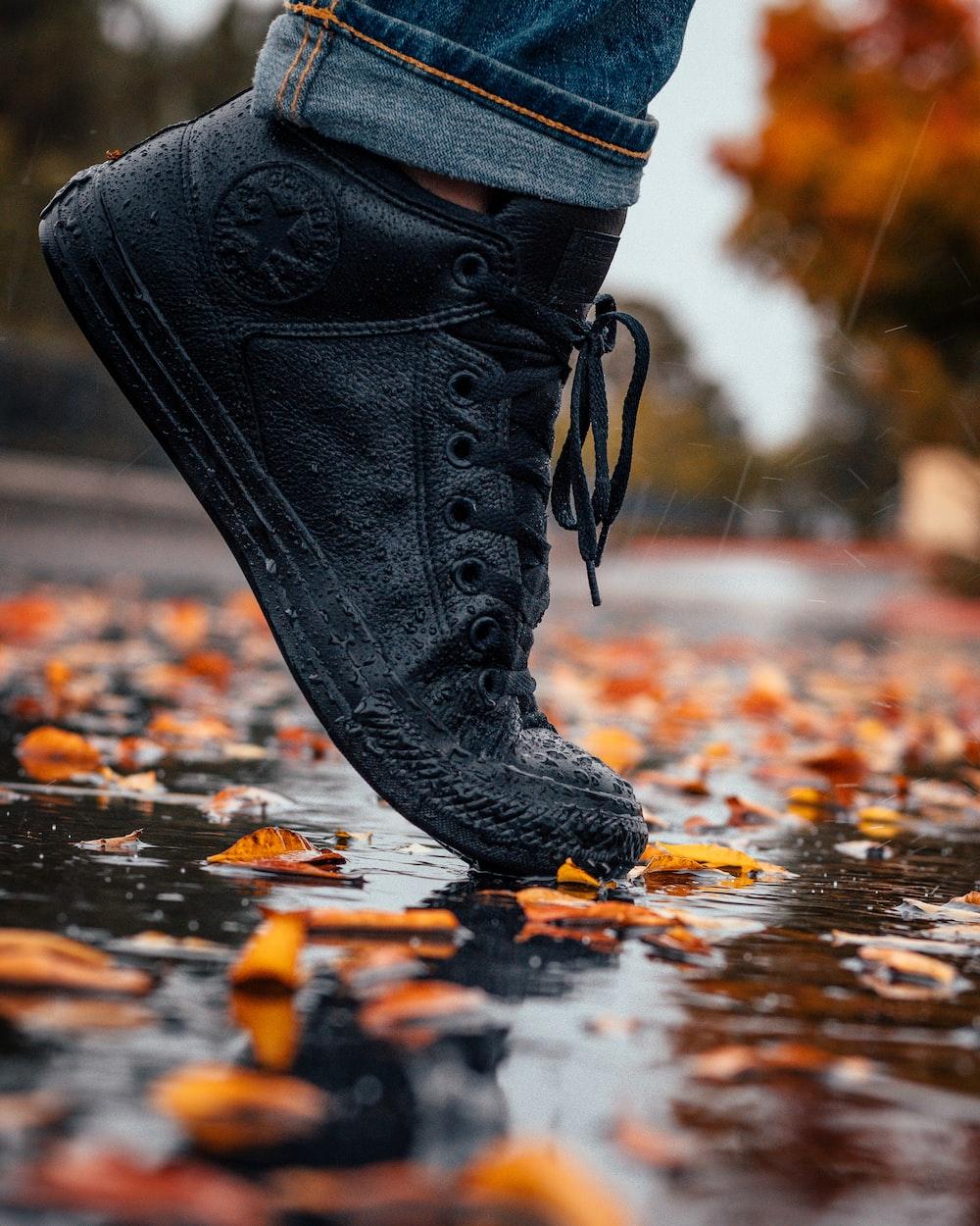 unpaired black Converse All-Star sneaker