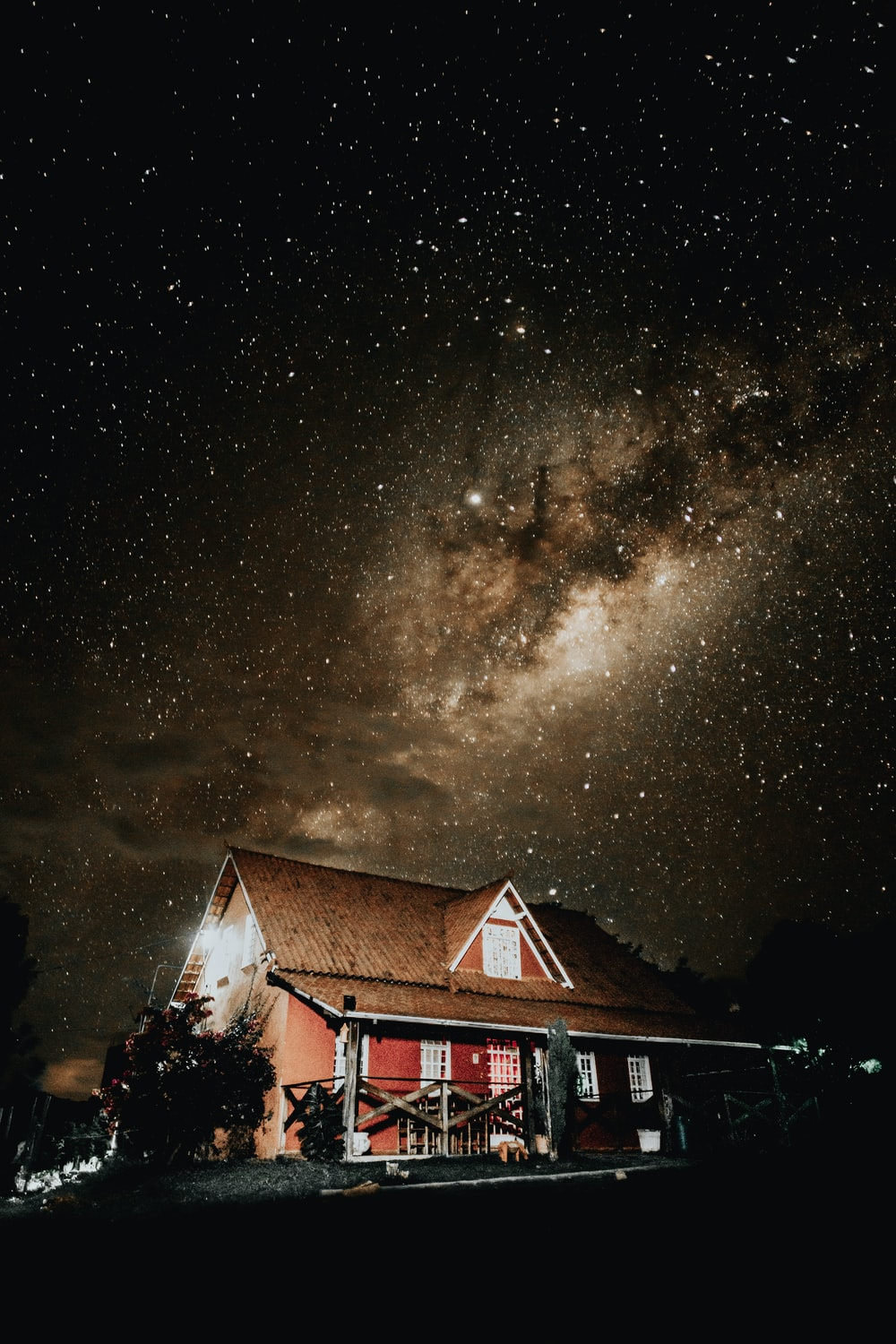 brown and red cottage at night