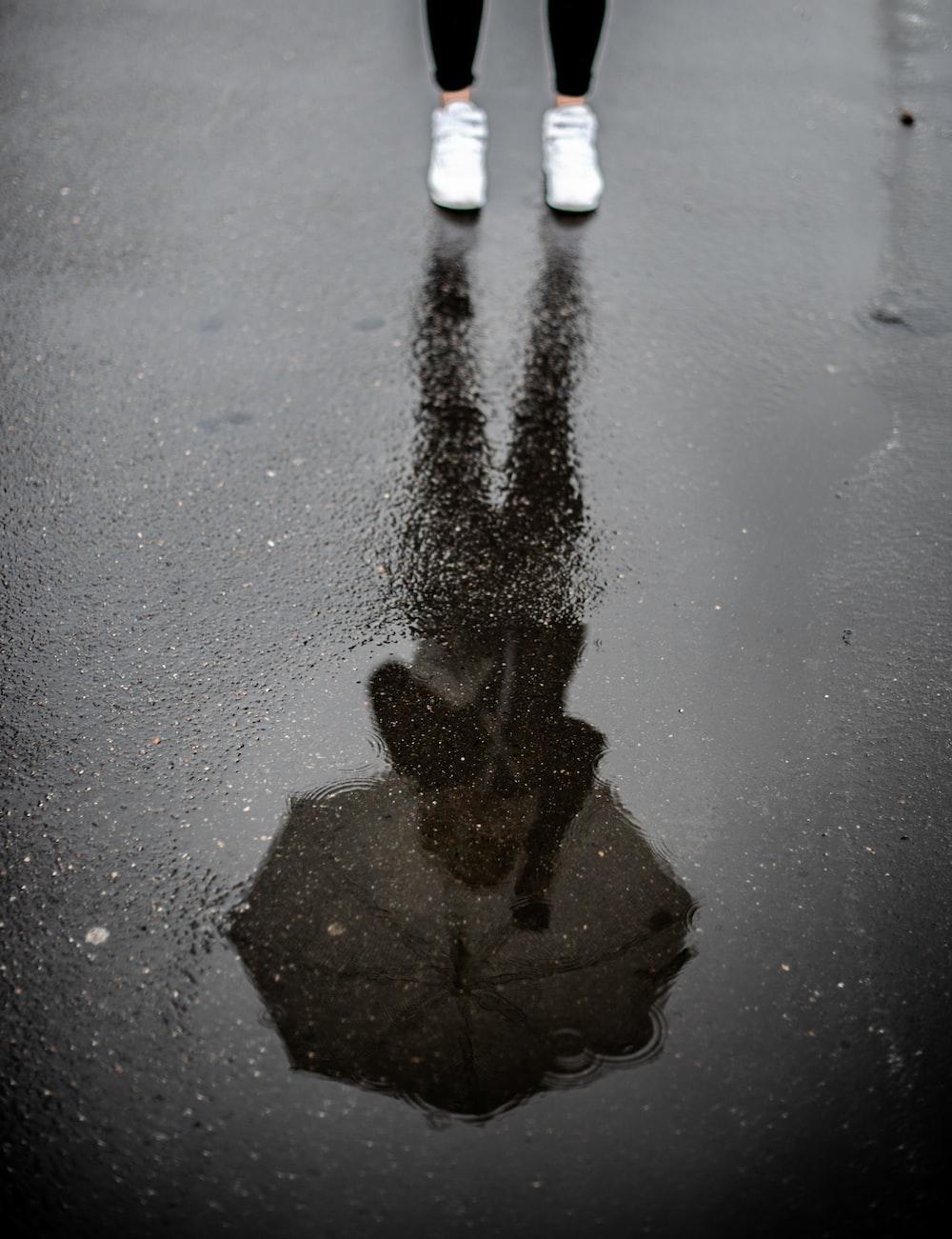 person holding umbrella