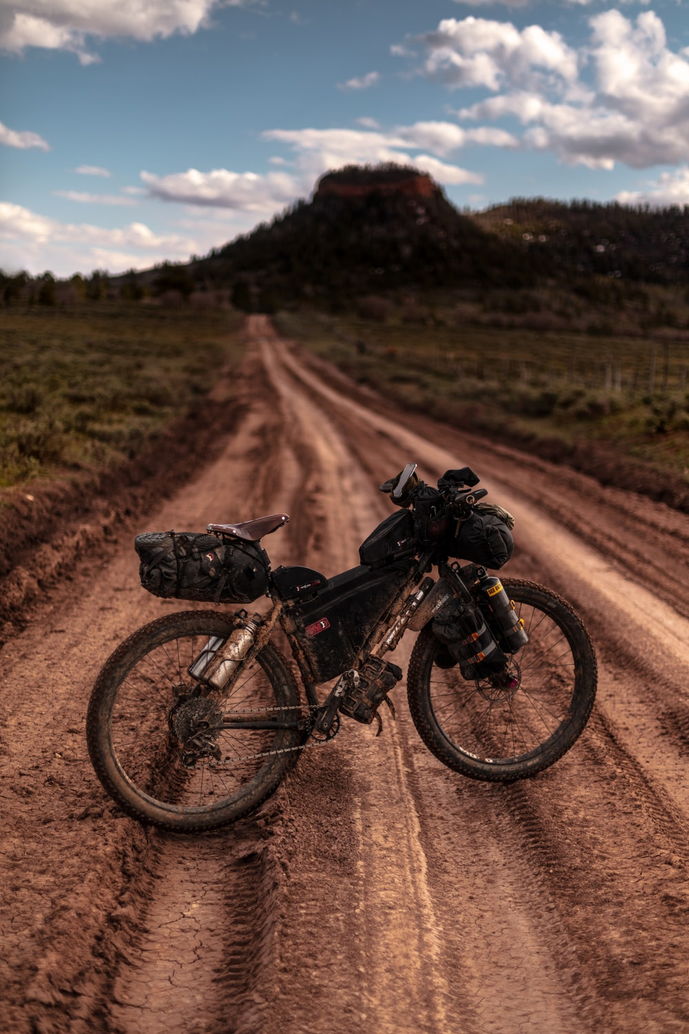 black motorized bicycle on dirt road