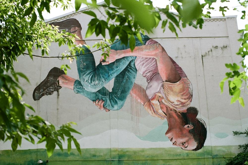 woman sitting on pavement painting