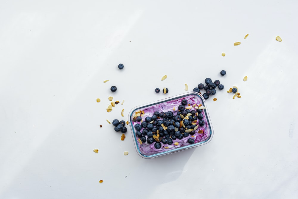 black berries on pink container