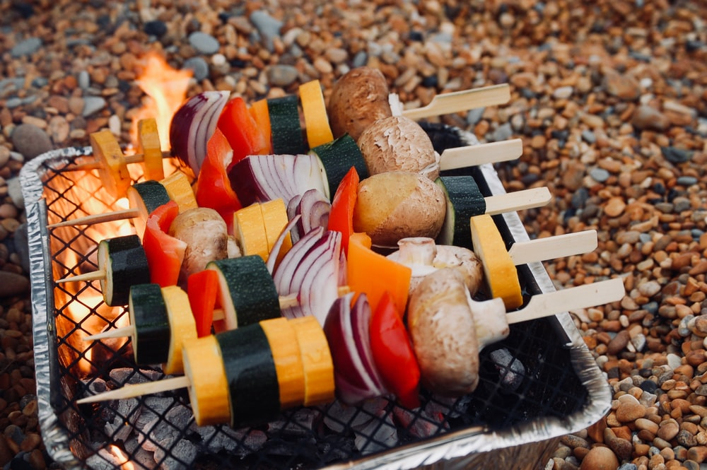 skewered vegetables on grill