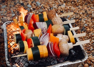 skewered vegetables on grill