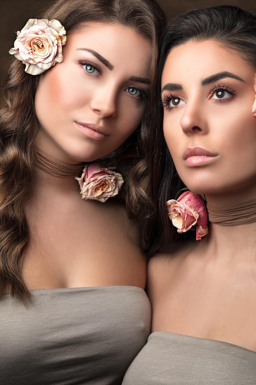 two women in grey tube tops