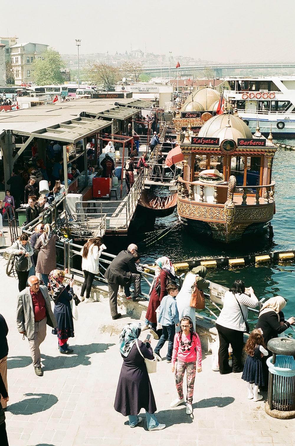 people walking near boat