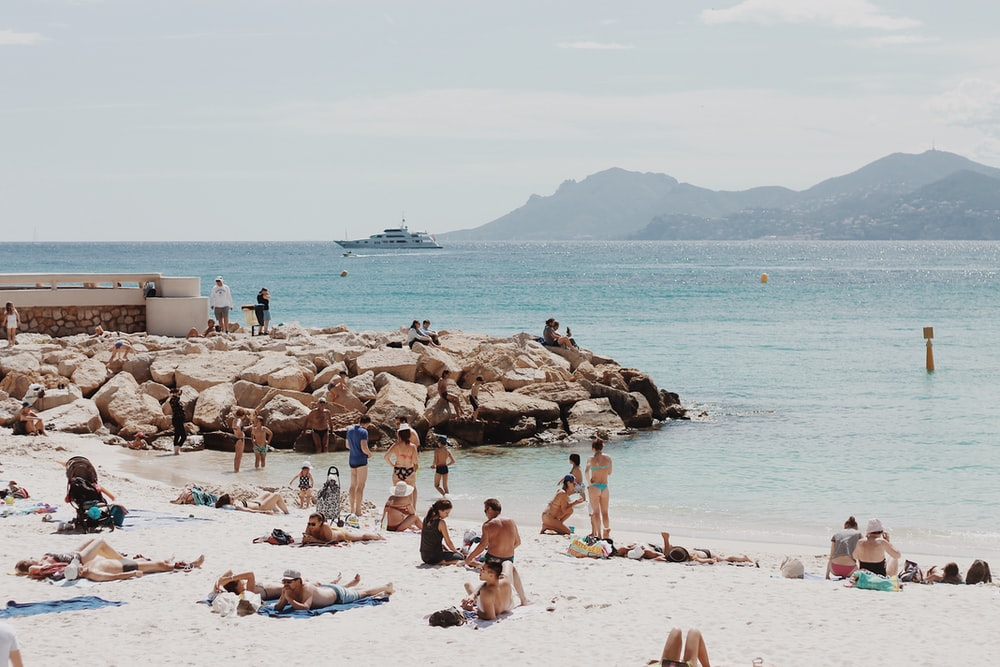 people gathered on seashore during daytime