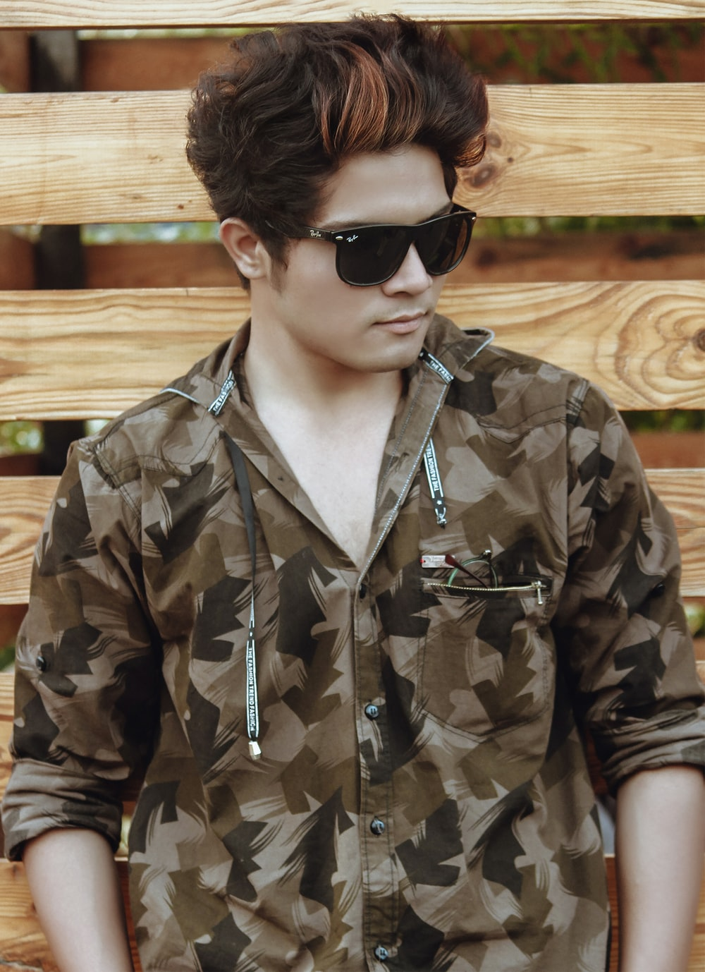 man wearing camouflage button-up jacket