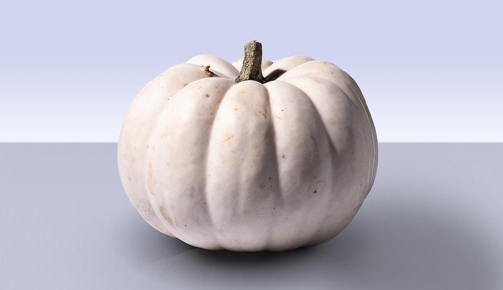gray pumpkin on gray surface