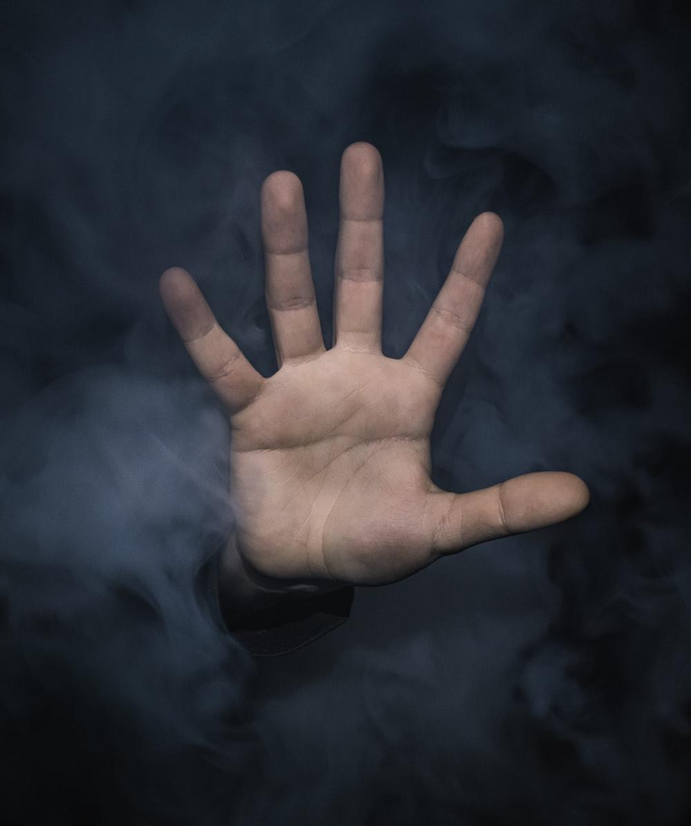 left human hand with smoke