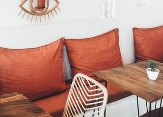 three red throw pillows behind tables