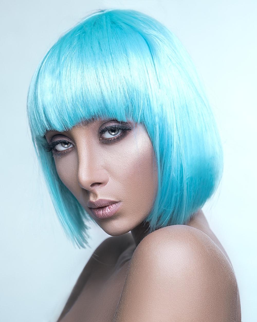 woman wearing blu wig