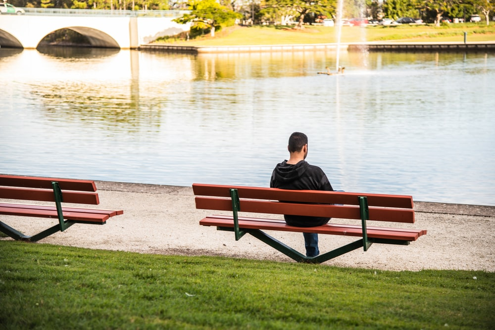 person sitting on bench