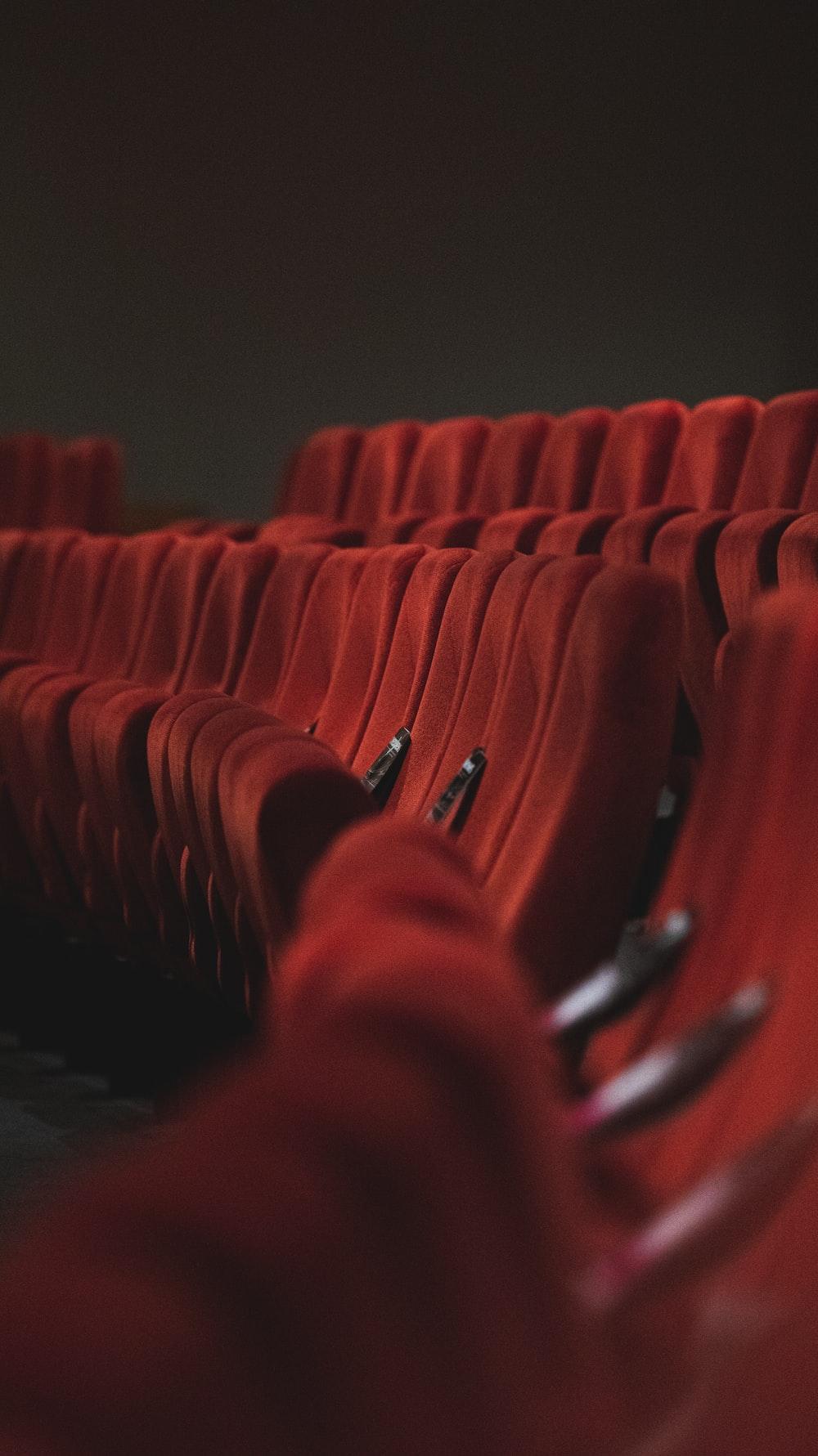 red fabric padded cinema chairs