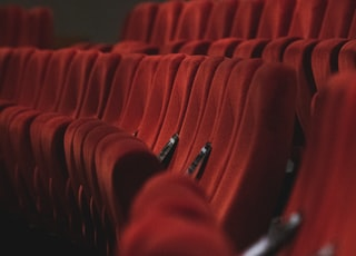 red fabric padded cinema chairs