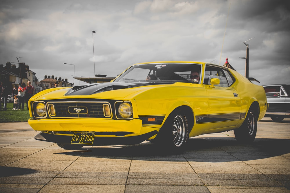 yellow Ford Mustang coupe